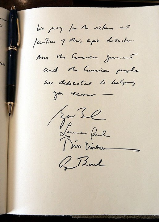 "Signed by former Presidents Bush and Clinton and Laura Bush, President Bush expressed their condolences during a visit to the embassy of Sri Lanka in Washington, D.C., Monday, Jan. 3, 2005. The President wrote, ""We pray for the victims and families of this epic disaster. And the American government and American people are dedicated to helping you recover."" White House photo by Eric Draper."
