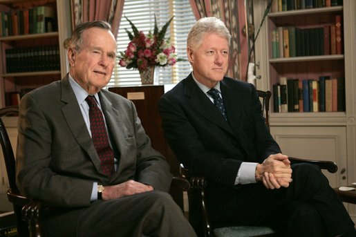 Former Presidents George H. W. Bush and Bill Clinton film a public service announcement encouraging the American people to make cash donations to the tsunami relief effort through www.usafreedomcorps.gov in the White House Library Wednesday, Jan. 5, 2005. White House photo by Eric Draper.