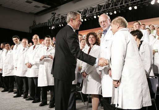 President George W. Bush greets physicians after discussing medical liability reform during a visit to Collinsville, Ill., Wednesday, Jan. 5, 2005. White House photo by Paul Morse.
