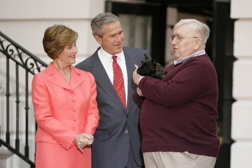 President George W. Bush and Laura Bush receive Miss Beazley, their new Scottish Terrier puppy, from breeder Bill Berry on the South Lawn of the White House Jan. 6, 2005. Miss Beazley is a birthday present from the President to Mrs. Bush. Beginning life at the White House in proper fashion, Miss Beazley's started her first day with a press conference. White House photo by Paul Morse.
