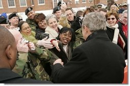 President George W. Bush greets people during a visit to Clinton Township, Mich., Friday, Jan. 7, 2005.  White House photo by Paul Morse