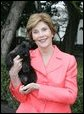 Laura Bush holds Miss Beazley shortly after the arrival of the 10-week-old Scottish terrier to the White House Thursday, Jan. 6, 2005. White House photo by Susan Sterner.