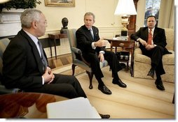 President George W. Bush talks with State Secretary Colin Powell and FEMA Director Mike Brown, far right, during an Oval Office briefing on the tsumami relief efforts Monday, Jan. 10, 2005.   White House photo by Eric Draper