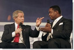 "President George W. Bush talks with Bob McFadden during a discussion about Social Security reform at the Andrew W. Mellon Auditorium in Washington, D.C., Jan. 11, 2005. ""I know that if we don't address the problem now, it will only get worse with time,"" President Bush said. ""And I believe there is a fundamental duty, for those of us who have been given the honor of serving the American people, to solve problems before they become acute, and not to pass them on to future Presidents and future generations.""  White House photo by Paul Morse"