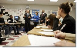 President George W. Bush, Mrs. Laura Bush and Secretary of Education Rod Paige talk to international baccalaureate program students of J.E.B. Stuart High School in Falls Church, VA on January 12, 2005.  White House photo by Paul Morse