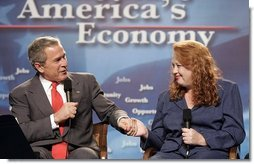 President George W. Bush talks with Kim Wilkerson during a conversation on higher education and job training at Florida Community College in Jacksonville, Fla., Friday, Jan. 14, 2005.   White House photo by Paul Morse