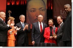 "Secretary of State Colin Powell and his wife Alma are accompanied by President George W. Bush and Mrs. Laura Bush while the Powell's received the John Thompson Legacy of a Dream Award from Georgetown University during the University's ""Let Freedom Ring"" celebration honoring Dr. Martin Luther King, Jr. at the Kennedy Center for the Performing Arts on Monday, January 17, 2005.  White House photo by Paul Morse"