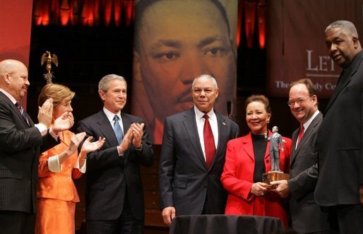 "Secretary of State Colin Powell and his wife Alma are accompanied by President George W. Bush and Mrs. Laura Bush while the Powell's received the John Thompson Legacy of a Dream Award from Georgetown University during the University's ""Let Freedom Ring"" celebration honoring Dr. Martin Luther King, Jr. at the Kennedy Center for the Performing Arts on Monday, January 17, 2005. White House photo by Paul Morse."