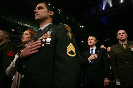 During an event honoring members of the U.S. military, President George W. Bush stands with U.S. Marine Corps Capt. Brian R. Chontosh, right, at the MCI Center in Washington, D.C., Tuesday, Jan. 18, 2005. White House photo by Eric Draper