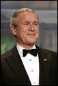 President George W. Bush listens as Vice President Dick Cheney introduces him during a Black Tie and Boots Ball in Washington, D.C., Jan 19, 2005. Chief Justice William Rehnquist will swear President Bush into office to serve his second term during the 55th Presidential Inauguration held Jan. 20, 2005. White House photo by Eric Draper