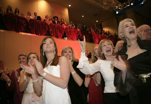 Audience members display the Texas Longhorn symbol in support of President Bush during the Texas State Society's Black Tie and Boots Inaugural Ball in Washington, D.C., Wednesday, Jan. 19, 2005. White House photo by Paul Morse