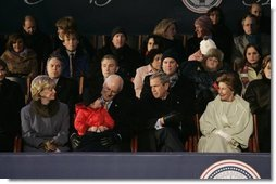 President George W. Bush and Laura Bush sit with Vice President Dick Cheney, Lynne Cheney, and their granddaughter, Grace Perry, during a concert commemorating the 55th Presidential Inauguration on the Ellipse in Washington, D.C., Wednesday, Jan. 19, 2005. White House photo by Eric Draper.