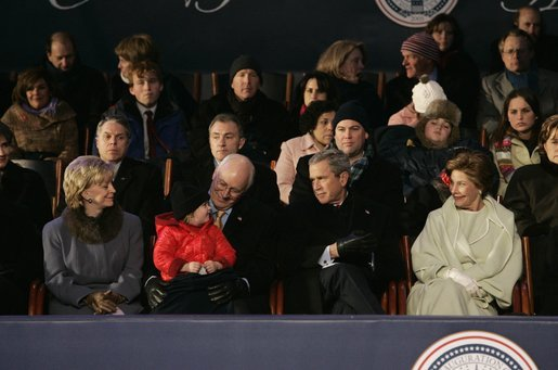 President George W. Bush and Laura Bush sit with Vice President Dick Cheney, Lynne Cheney, and their granddaughter, Grace Perry, during a concert commemorating the 55th Presidential Inauguration on the Ellipse in Washington, D.C., Wednesday, Jan. 19, 2005. White House photo by Eric Draper