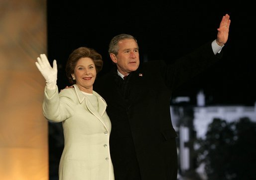 President George W. Bush and Laura Bush arrive on stage for a fireworks display during the inaugural concert 'A Celebration of Freedom' on the Ellipse south of the White House, Wednesday, Jan. 19, 2005. White House photo by Eric Draper