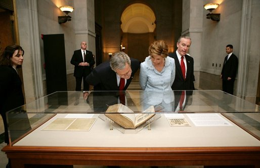 President George W. Bush and Laura Bush tour the National Archives in Washington, D.C., Wednesday, Jan. 19, 2005. National Archives Senior Curator Stacy Bredhoff, left, and National Archivist John Carlin, right, escorted the Bushes during their visit. White House photo by Eric Draper