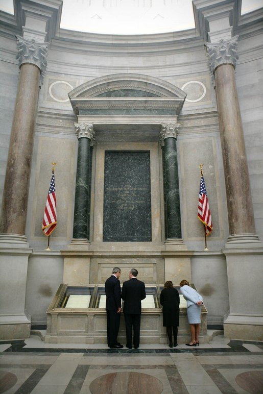 President George W. Bush and Laura Bush view the U.S. Constitution with National Archivist John Carlin, second on left, and Senior Curator Stacy Bredhoff, second on right, while touring the National Archives in Washington, D.C., Wednesday, Jan. 19, 2005. The Bushes also looked at the Declaration of Independence, George Washington's handwritten inaugural address, George Washington and President George H. W. Bush's inaugural Bible, and the Bill of Rights. White House photo by Eric Draper