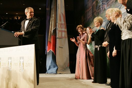 After an introduction by Vice President Dick Cheney, President George W. Bush talks at the Black Tie and Boots Inaugural Ball in Washington, D.C., Wednesday, Jan. 19, 2005. Also pictured are, from left, Jenna Bush, Barbara Bush, Laura Bush, Congresswoman Kay Granger, Vice President Cheney and Lynne Cheney. White House photo by Susan Sterner