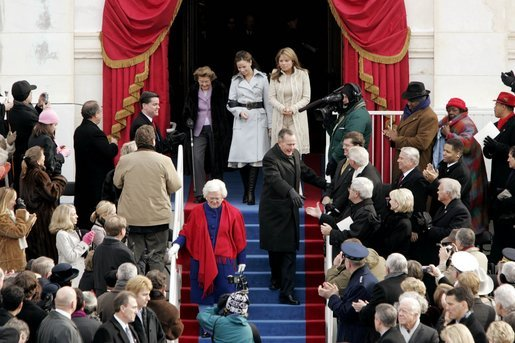 Former President George H. W. Bush and former First Lady Barbara Bush lead Jenna Welch, Barbara Bush and Jenna Bush to their seats to watch the swearing-in ceremony of President George W. Bush at the U.S. Capitol, Jan. 20, 2005. White House photo by Paul Morse