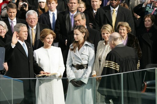 With his left hand resting on a family Bible, President George W. Bush takes the oath of office to serve a second term as 43rd President of the United States during a ceremony at the U.S. Capitol, Thursday, Jan. 20, 2005. Laura Bush, Barbara Bush, and Jenna Bush listen as Chief Justice William H. Rehnquist administers the oath. White House photo by Susan Sterner