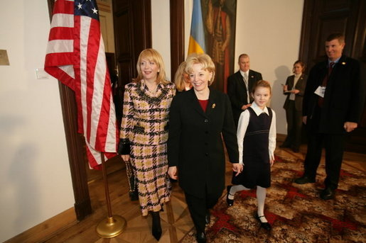 Lynne Cheney walks with Mrs. Viktor Yushchenko during a meeting in Krakow, Poland, Jan. 26, 2005. White House photo by David Bohrer