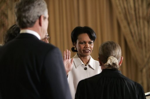 As President George W. Bush watches, Justice Ruth Bader Ginsburg ceremoniously swears in Dr. Condoleezza Rice Friday, Jan. 28, 2005, as Secretary of State. Secretary Rice officially was sworn in Wednesday after her 85-13 Senate confirmation. White House photo by Eric Draper