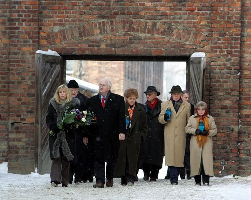 Vice President Dick Cheney and his daughter Liz Cheney, left, walk with other members of a U.S. delegation before paying respects at The Wall of Death at the Auschwitz-1 Nazi concentration camp, near Krakow, Poland, Jan. 28, 2005. Vice President Cheney was there to take part in ceremonies commemorating the 60th Anniversary of the liberation of the Auschwitz camps. The Wall of Death was named for its use as the backdrop for firing squads where thousands of prisoners were executed while the camp was in operation. White House photo by David Bohrer