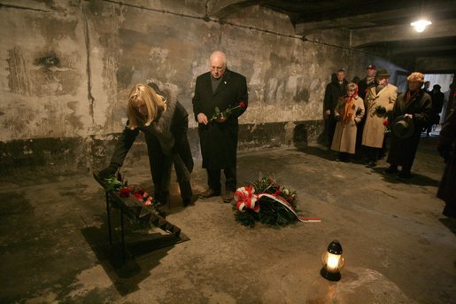 Vice President Dick Cheney and his daughter Liz Cheney, left, along with other members of a U.S. delegation, lay flowers at a memorial inside the first gas chamber at the Auschwitz-1 Nazi concentration camp, near Krakow, Poland, Jan. 28, 2005. Vice President Cheney was there to take part in ceremonies commemorating the 60th Anniversary of the liberation of the Auschwitz camps. The Wall of Death was named for its use as the backdrop for firing squads where thousands of prisoners were executed while the camp was in operation. White House photo by David Bohrer