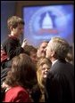 President George W. Bush talks with a young boy prior to delivering remarks on his legislative priorities and initiatives for the 109th Congressional session of Congress during a retreat in White Sulphur Springs, W.V., Friday, Jan. 28, 2005. White House photo by Paul Morse
