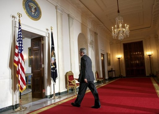 President George W. Bush leaves the podium after delivering a statement on Iraq's elections from the Cross Hall of the White House, Sunday, Jan. 30, 2005. White House photo by Eric Draper.
