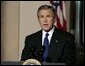 President George W. Bush delivers a live televised statement on Iraq's elections from the Cross Hall of the White House, Sunday, Jan. 30, 2005. White House photo by Eric Draper.