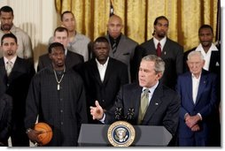 President George W. Bush congratulates the Detroit Pistons on winning the 2004 NBA Championship during a ceremony in the East Room of the White House, Monday, Jan. 31, 2005.  White House photo by Paul Morse