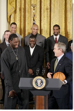 During a ceremony honoring the Detroit Pistons for winning the 2004 NBA Championship, President George W. Bush shares a laugh with basketball player Ben Wallace in the East Room, Jan. 31, 2005.  White House photo by Paul Morse
