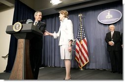 President George W. Bush congratulates Margaret Spellings, the new Secretary of Education, during her swearing-in ceremony at the Department of Education in Washington, D.C., Monday, Jan. 31, 2005. Also pictured, right, is Secretary Spellings husband, Robert Spellings.   White House photo by Paul Morse