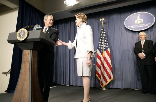 President George W. Bush congratulates Margaret Spellings, the new Secretary of Education, during her swearing-in ceremony at the Department of Education in Washington, D.C., Monday, Jan. 31, 2005. Also pictured, right, is Secretary Spellings husband, Robert Spellings. White House photo by Paul Morse.
