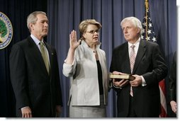 With President George W. Bush and her husband Robert Spellings by her side, Secretary of Education Margaret Spellings takes the oath of office during a ceremony at the Department of Education in Washington, D.C., Monday, Jan. 31, 2005. Secretary Spellings served as an Assistant to the President for Domestic Policy during the first term of the Bush administration.  White House photo by Paul Morse