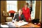 With Laura Bush looking on, President George W. Bush signs a proclamation designating February as American Heart Month in the Oval Office, Feb. 1, 2005. The proclamation encourages awareness of factors leading to heart disease such as smoking, high cholesterol, lack of exercise, obesity and diabetes. White House photo by Susan Sterner