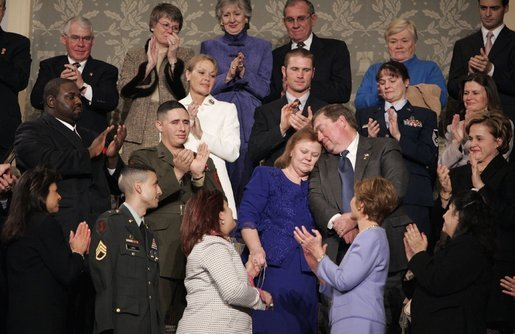 "During the State of the Union Address Wednesday, Feb. 2, 2005, Janet and William Norwood, center, comfort each other as President Bush talks about their son, Marine Corps Sergeant Byron Norwood of Pflugerville, Texas, who died during the assault on Fallujah. ""Ladies and gentlemen, with grateful hearts, we honor freedom's defenders, and our military families, represented here this evening by Sergeant Norwood's mom and dad, Janet and Bill Norwood,"" President Bush said during his speech at the U.S. Capitol. White House photo by Eric Draper"