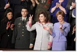 Safia Taleb al-Suhail, leader of the Iraqi Women's Political Council, second on right, displays a peace sign as other guests applaud during President George W. Bush's State of the Union speech at the U.S. Capitol, Wednesday, Feb. 2, 2005. Also pictured are, from left, Kindergarten teacher Lorna Clark of Santa Theresa, New Mexico, Army Staff Sergeant Norbert Lara, and Laura Bush.   White House photo by Paul Morse