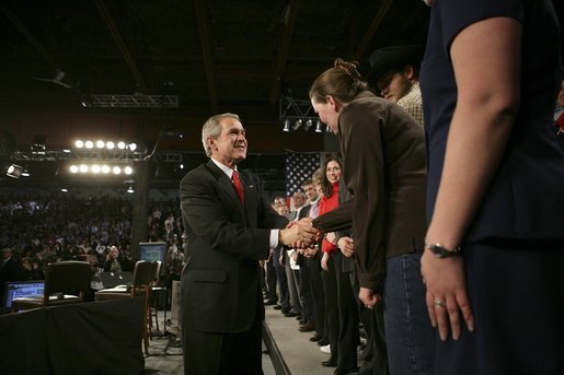 "President George W. Bush greets audience members after holding a conversation about the strengthening of Social Security at ExpoPark in Great Falls, Mont., Feb., 3, 2005. ""I believe you ought to be able -- allowed to take some of your own money, payroll taxes, and set up a personal retirement account, on a voluntary basis,"" said the President in his remarks. White House photo by Eric Draper"