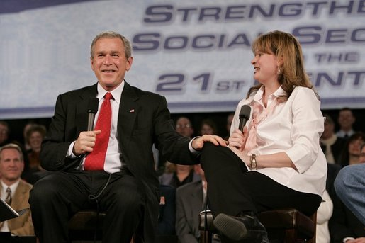 President George W. Bush and librarian Amy Borger talk about the strengthening of Social Security during a Town Hall meeting at the Montana ExpoPark in Great Falls, Mont., Thursday, Feb. 3, 2005. White House photo by Eric Draper