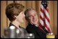 President George W. Bush and Laura Bush laugh during the National Prayer Breakfast in Washington, D.C., Thursday, Feb. 3, 2005. White House photo by Paul Morse
