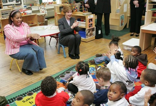 Laura Bush joins pre-school teacher Georgianna Ragland's class in a song during her visit to the Germantown Boys and Girls Club Tuesday, Feb. 3, 2005 in Philadelphia. Mrs Bush highlighted the importance of programs that support youth, especially at-risk boys. White House photo by Susan Sterner