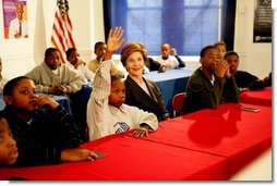 Laura Bush listens as boys participating in the Passport to Manhood program share ideas about respect and love during a visit to the Germantown Boys and Girls Club Tuesday, Feb. 3, 2005 in Philadelphia. Passport to Manhood promotes and teaches responsibility through a series of male club members ages 11-14.  White House photo by Susan Sterner