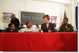 Laura Bush addresses young boys participating in the Passport to Manhood program taught by male staff members at the Germantown Boys and Girls Club Tuesday, Feb. 3, 2005 in Philadelphia. Passport to Manhood promotes and teaches responsibility through a series of classes for male club members ages 11-14.  White House photo by Susan Sterner
