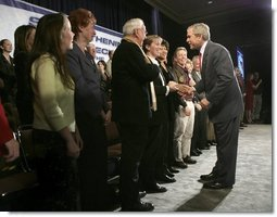 President George W. Bush greets audience members at the end of the Town Hall on Strengthening Social Security at the Tampa Convention Center in Tampa, Florida, Friday, Feb. 4, 2005.