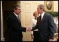 President George W. Bush welcomes Secretary of Commerce Carlos Gutierrez and his wife Edilia Gutierrez to the Oval Office Monday, Feb. 7, 2005. Mr. Gutierrez, a native of Cuba and former chairman of the board and chief executive officer of the Kellogg Company, was sworn in by White House Chief of Staff Andrew Card earlier in the day. White House photo by Eric Draper