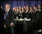 President George W. Bush receives applause during his introduction at the Detroit Economic Club in Detroit, Michigan, Tuesday, Feb. 8, 2005. White House photo by Eric Draper.