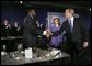 President George W. Bush greets Detroit Mayor Kwame Kilpatrick after delivering remarks at the Detroit Economic Club in Detroit, Michigan, Tuesday, Feb. 8, 2005. Also pictured at center is Detroit Economic Club President Beth Chappell. White House photo by Eric Draper