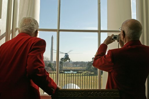 Members of the famed Tuskegee Airmen watch as President Bush returns to the White House aboard Marine One Tuesday, Feb. 8, 2005. The Airmen were at the White House to attend a ceremony honoring February as African American History Month. White House photo by Susan Sterner