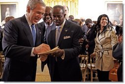 After speaking, President Bush greets guests during a ceremony honoring February as African American History Month Tuesday, Feb. 8, 2005.   White House photo by Paul Morse